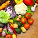 Assortment of fresh Organic Vegetables /  on the Wooden Desk