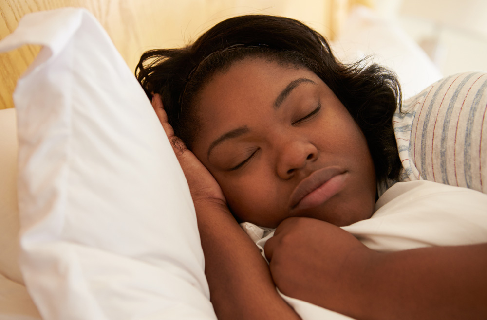 Close Up Of Overweight Woman Asleep In Bed